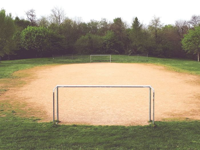View of soccer field against trees