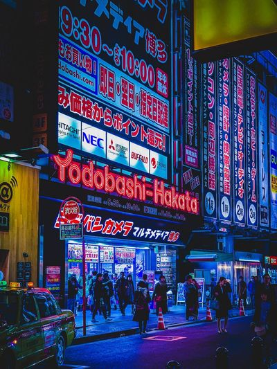 Hakata Fukuoka Japan ShotOnIphone Japan Photography Illuminated City Built Structure Building Exterior Architecture Communication Text Large Group Of People Crowd City Life Walking Street Sign Night Advertisement Script Real People Group Of People Western Script Commercial Sign