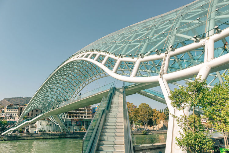 Low angle view of bridge and building against sky