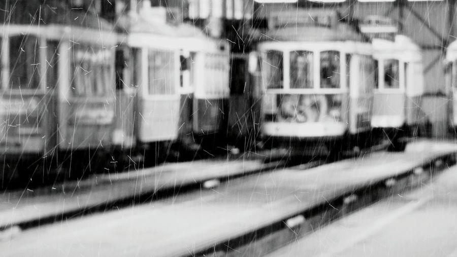 The Rain Drops it is a Rainy Day City Explorer Public Transportation Blurred Background Yellow Train Public Transport Taking Photos City Transportation Old Transport City Trans Black And White Black & White Transportation Tourist Attraction  Garage Showcase April