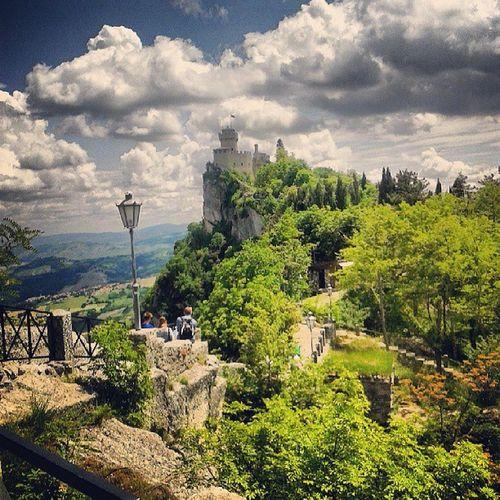 San Marino Castle Italy sun clouds