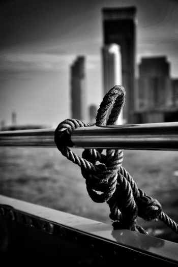 Close-up of rope on railing against sky