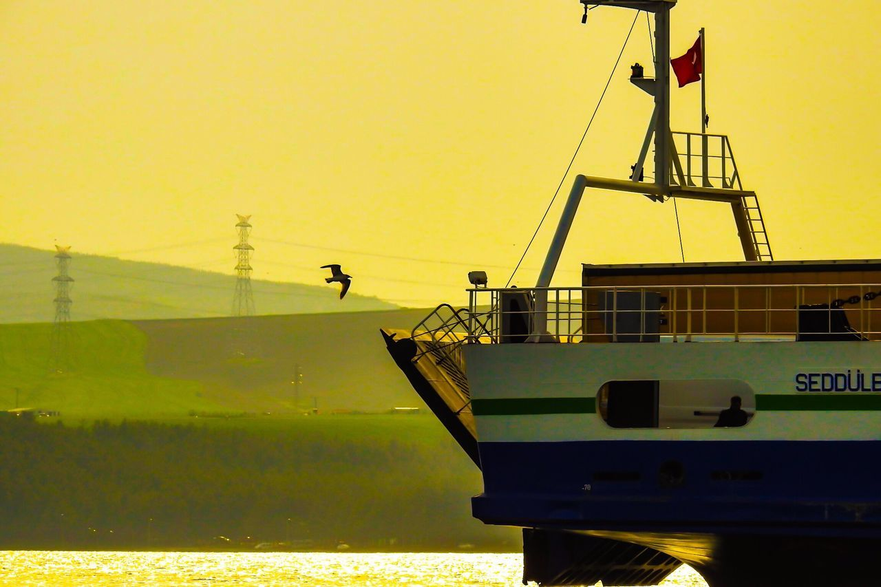 transportation, mode of transport, water, outdoors, nautical vessel, day, sea, men, sky, clear sky, nature, one person, sunset, occupation, scenics, beauty in nature, one man only, people, oil pump