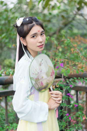 China Long Hair One Person Beautiful People Chinese Clothes Nature Beauty Cultures Charming Portrait Flower Outdoors