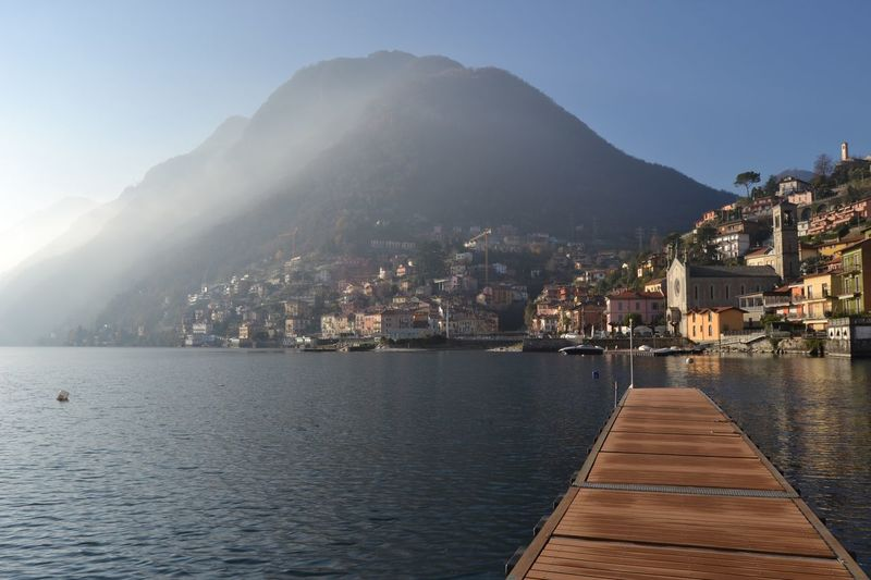 Argegno (Como, Italy) Riflessi Reflection Sole Sun Fog Nebbia Water Acqua Montagne Mountain Como Argegno Como Lake Lago Di Como Lake View Lake View Lago Water Mountain Sky City Nature No People Waterfront Scenics - Nature Beauty In Nature Day Mountain Range Outdoors Cityscape