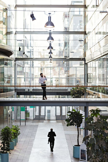 Man walking in modern building