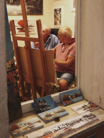Senior Men Painting On Easel At Home