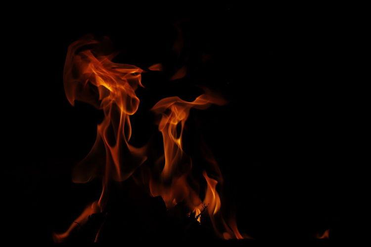 Close-up of bonfire against black background