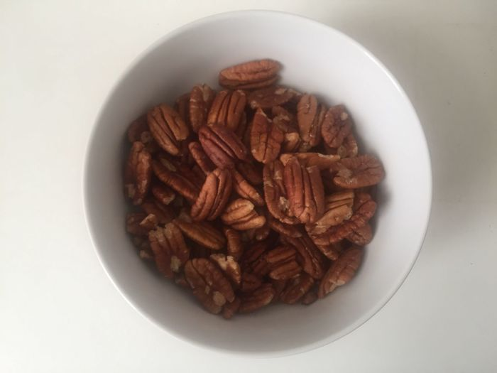 Bowl Food And Drink Food Healthy Eating No People White Background Directly Above Freshness Indoors  Close-up Studio Shot Ready-to-eat Day Nuts Pecan Pecan Nuts Diabetes Nutrition