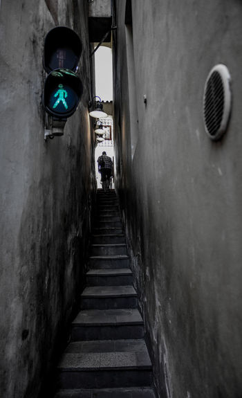 Alley Architecture Building Building Exterior Built Structure City Day Direction Footpath Incidental People Leisure Activity Lifestyles Men Nature Outdoors People Real People Staircase The Way Forward Transportation Wall - Building Feature
