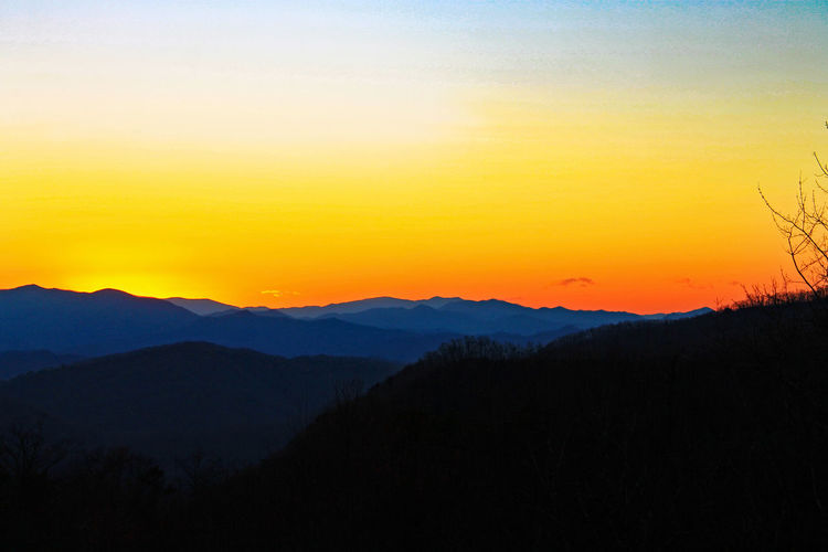 Beauty In Nature Clear Sky Landscape Mountain Mountain Range Nature No People Orange Color Outdoor Photography Outdoors Scenics Silhouette Sky Sunset Tranquil Scene Tranquility Water Waterfall Go Higher
