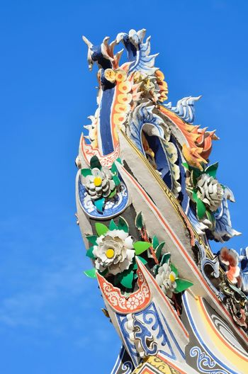 Low Angle View Of Chinese Dragon Against Sky