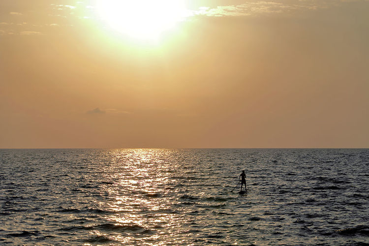 minimal art + landscape + sunset Seascape Yellow Water Sea Sunset Beach Multi Colored Backgrounds Sunlight Summer Sun Silhouette Seascape Horizon Over Water Ocean Low Tide Coastal Feature Wave Dramatic Sky Atmospheric Mood Moody Sky Tide My Best Travel Photo