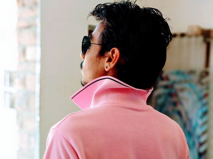 Rear view of man in pink t-shirt