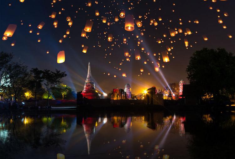 Illuminated Lanterns In Water At Night