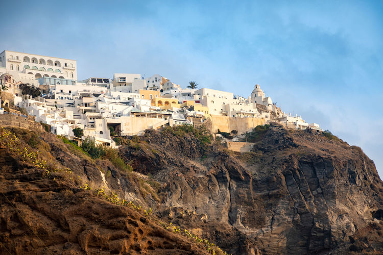 Santorini Greece Building Exterior Architecture Sky Rock Built Structure Nature Solid Rock Formation Rock - Object Mountain Building Day City Travel Destinations Cloud - Sky Residential District No People Outdoors Travel Land TOWNSCAPE