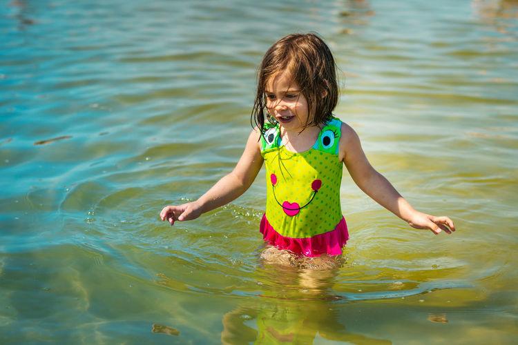 Girl walking in sea