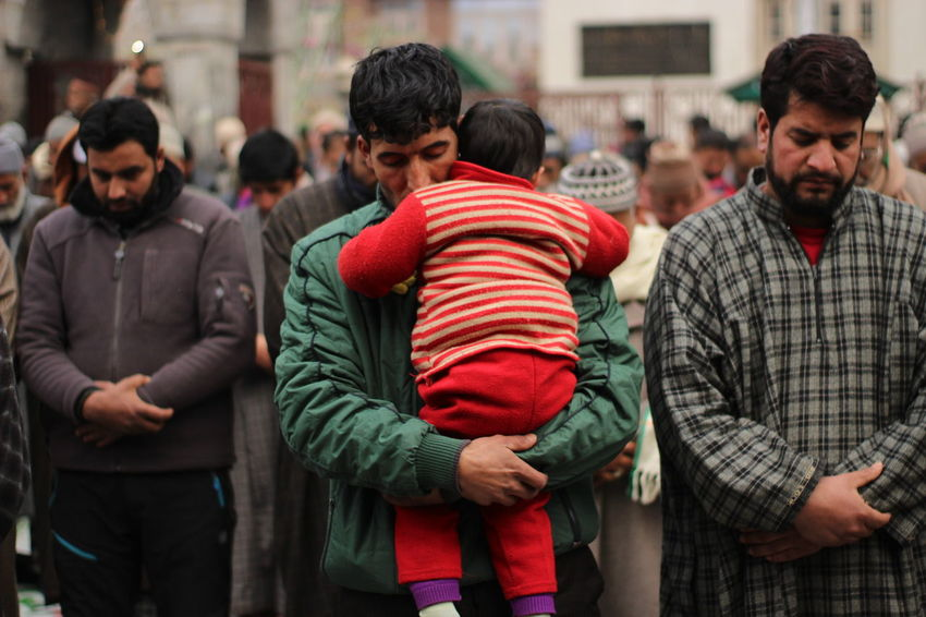 A kashmiri muslim man offering prayers while holding his son in Lap on the following friday of urs sheikh Syed abdul qadir jeelani downtown khanyar Srinagar 5,January, 2018 Kashmir India Daily Life The Still Life Photographer - 2018 EyeEm Awards Devotees Dailylife Gettyimages Srinagar Kashmir The Photojournalist - 2018 EyeEm Awards Warm Clothing City Friendship Politics And Government Crowd Men Winter Togetherness Couple - Relationship Group Of People Humanitarian Aid Protestor City Street Zebra Crossing Non-profit Organization Political Rally Social Services Protest Waiting In Line Charitable Donation Altruism The Creative - 2018 EyeEm Awards A New Beginning