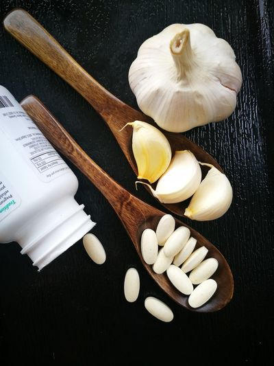 Garlic Ingredient Still Life High Angle View No People Studio Shot Food And Drink Indoors  Black Background Food Freshness Close-up Day White Color Garlic Supplement Healthy Eating Garlic Plant Garlic Clove Garlic Bulbs Garlic!