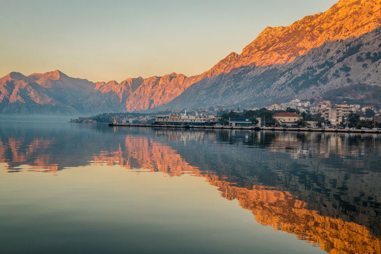 Kotor Bay in Montenegro Kotor Kotor, Montenegro Kotor Bay Mountain Reflection Water Sky Lake Beauty In Nature Scenics - Nature Tranquility Mountain Range Waterfront Tranquil Scene No People Nature Idyllic Non-urban Scene Day Sunset Outdoors Orange Color