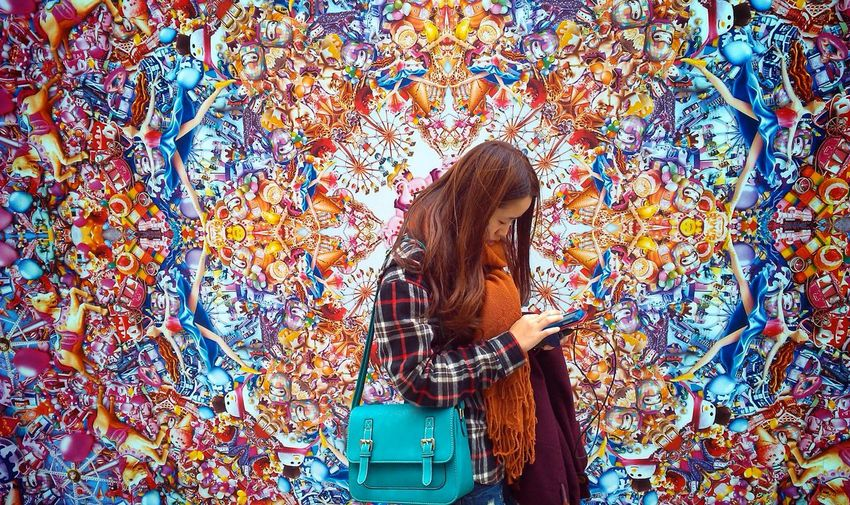 Young Woman In Front Of Colorful Artwork