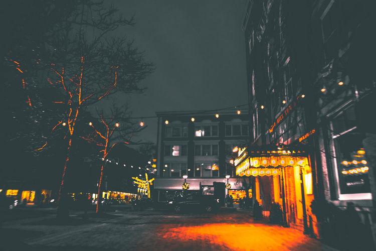 Dark Light Nightphotography Trees Architecture Building Building Exterior Buildings Built Structure City City Street Illuminated Illumination Light And Shadow Night No People Real People Sky Street Street Light Streetphotography Urban The Traveler - 2018 EyeEm Awards