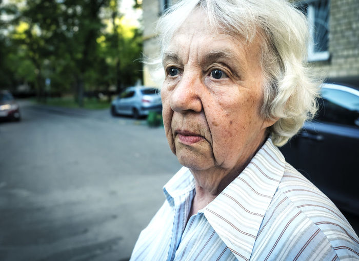 Adult Car City Close-up Day Focus On Foreground Gray Hair Hairstyle Headshot Human Face Lifestyles Looking At Camera Motor Vehicle One Person Portrait Real People Senior Adult Senior Women Street White Hair Women Wrinkled