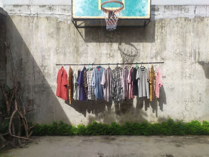 Clothes drying against wall in city