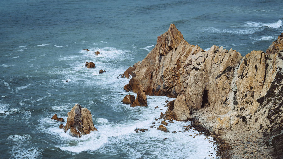 The hidden caves of Cabo da Roca Beauty In Nature High Angle View Landscape Motion Rock Rock Formation Scenics - Nature Sea Water Wave