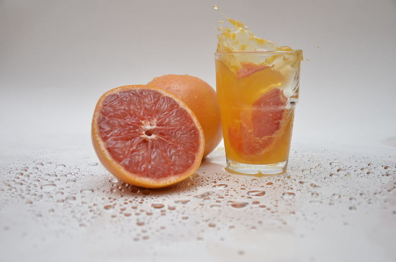 Sour in the glass Orange Citrus Fruit Drink Drinking Glass Fresh Orange Juice Freshness Fruit Fruit Juice Glass Healthy Eating Hi Key Portrait Indoor Photography Orange Orange - Fruit Orange Color Orange Juice In Glass Refreshment SLICE Studio Shot Tricky Pic EyeEmNewHere This Is Strength