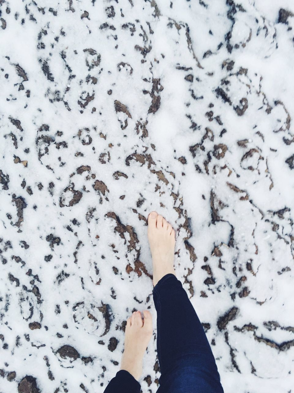 Low Section Of Woman Walking On Snow