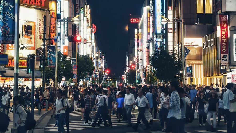 Crowd on illuminated tokyo street at night