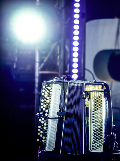 accordion on stage before the concert Accordion Stage Before Performance Concert Light No People Indoors  Close-up Focus On Foreground Music Arts Culture And Entertainment Musical Instrument Musical Equipment Illuminated Still Life Microphone Input Device Selective Focus Technology Stage - Performance Space Machinery Percussion Instrument Guitar Nightlife