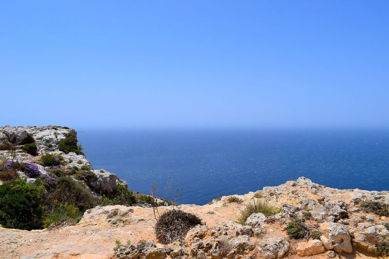 Cliff EyeEmNewHere Sea Water Scenics - Nature Sky Beauty In Nature Nature Land Tranquility Blue Copy Space Tranquil Scene Clear Sky Horizon Over Water Horizon Rock Day Rock - Object Sunlight No People