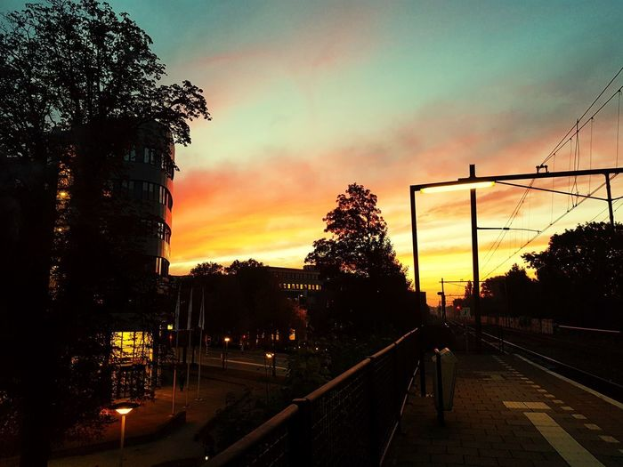 Picture made early in the morning in Arnhem, the Netherlands. Nederland Netherlands Arnhem Railway Sky Sky And Clouds Train Sunset Tree Sky Plant Nature Transportation Cloud - Sky No People Architecture Orange Color Outdoors