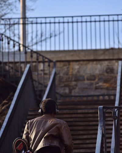 Rear View Of Man On Stairway