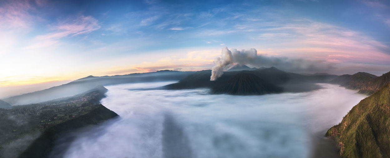Scenic view of volcanic mt bromo against sky during sunrise