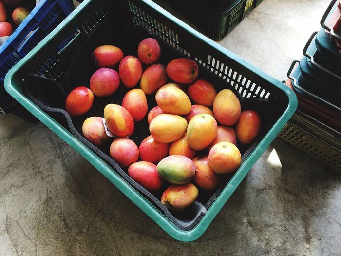 High angle view of fruits in basket at shop for sale
