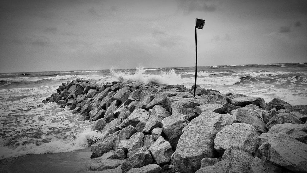Sea Sky No People Outdoors Blackandwhite Day Sand Freshness Beauty In Nature Fragility Rocks And Water Waves Crashing