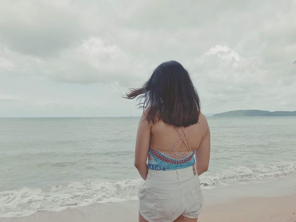 Alone Sea Beach Water Land Sky Leisure Activity Horizon Rear View Standing Cloud - Sky One Person Real People Outdoors