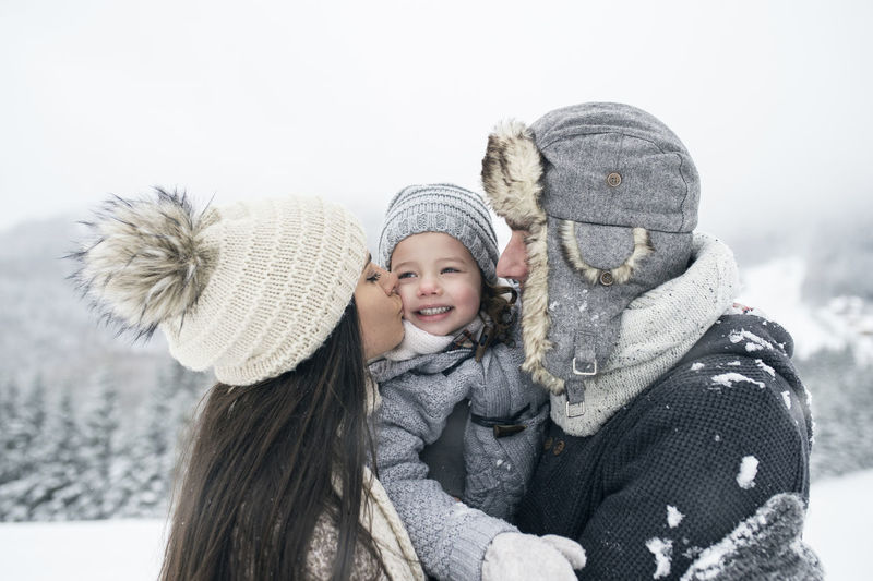 Portrait of smiling girl with snow