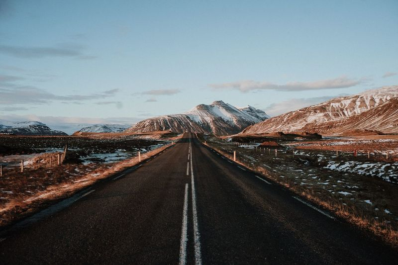 A road throug Iceland Travel Iceland Road The Way Forward Sky Direction Transportation Diminishing Perspective vanishing point Mountain Nature Road Marking No People Scenics - Nature Asphalt Environment Beauty In Nature Landscape