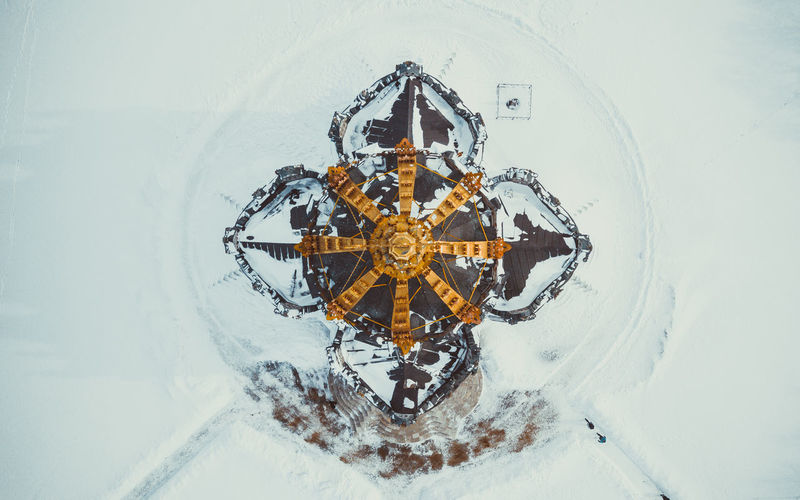 High angle view of snow on street amidst buildings in city