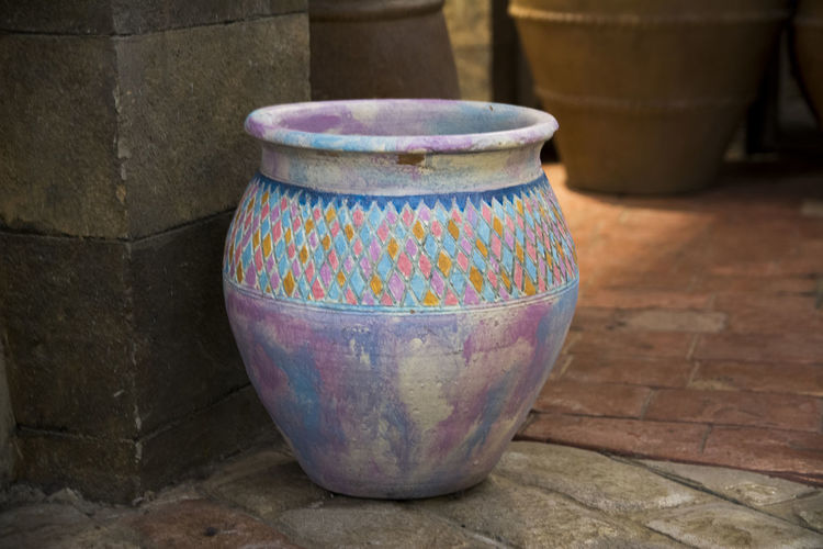 Art And Craft Ceramics Close-up Container Craft Creativity Day Flooring Floral Pattern Focus On Foreground Indoors  Multi Colored No People Pattern Pitcher - Jug Pottery Single Object Still Life Table Wall - Building Feature Wood - Material