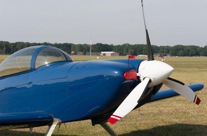 Aircraft on field against sky