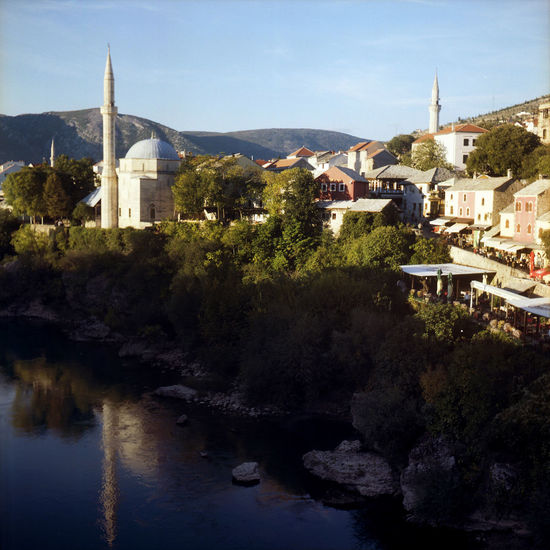 Architecture Balkan Bosnia And Herzegovina Cityscape Clear Sky Evening Light Mostar Mostar Bosnia Mostar Bridge Mostar ♥ Balkans Film Photography Minaret Minaret Mosque Mosque Mountain Neretva Neretva River No People Old Town Mostar Reflections In The Water Town EyeEmNewHere