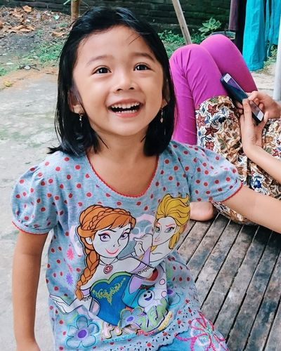 EyeEm Selects Looking At Camera Portrait One Person Smiling Girls Happiness People Real People Day Outdoors Front View One Girl Only Leisure Activity Children Only Childhood Cheerful Child Sitting Protruding Adult Inner Power