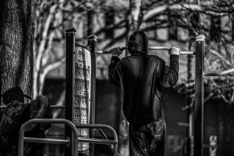 Stay Tuned Atlanta Blackandwhite Casual Clothing Day Exercise Fitness Focus On Foreground Holding Leisure Activity Lifestyles Men Nikon D750 One Person Outdoors Person Photographyisthemuse Rear View Standing Streetphotography Strong Tamron 70-200mm F/2.8 Three Quarter Length Waist Up The Street Photographer - 2016 EyeEm Awards