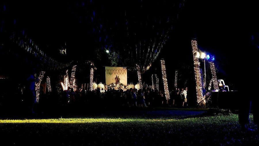 Illuminated lights on field in city at night