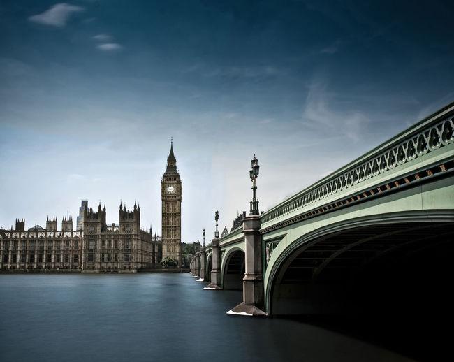 Westminster Bridge Over River Leading Towards Big Ben Against Sky In City